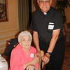 Fr. John Ross Sima, SJ enjoys catching up with his second cousin, Betty Anthony.