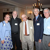 Fr. Joe Mulligan, SJ greets guests Joan Marie Coward, Joe Check, Dennis McNeil and Don Gimbel