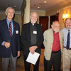 Fr. Joe Mulligan, SJ with Dennis McNeil, John O'Neal and John Sealey.