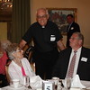 Fr. John Ross Sima, SJ visits with Tim Smith, Florence Selko and Bob Selko.