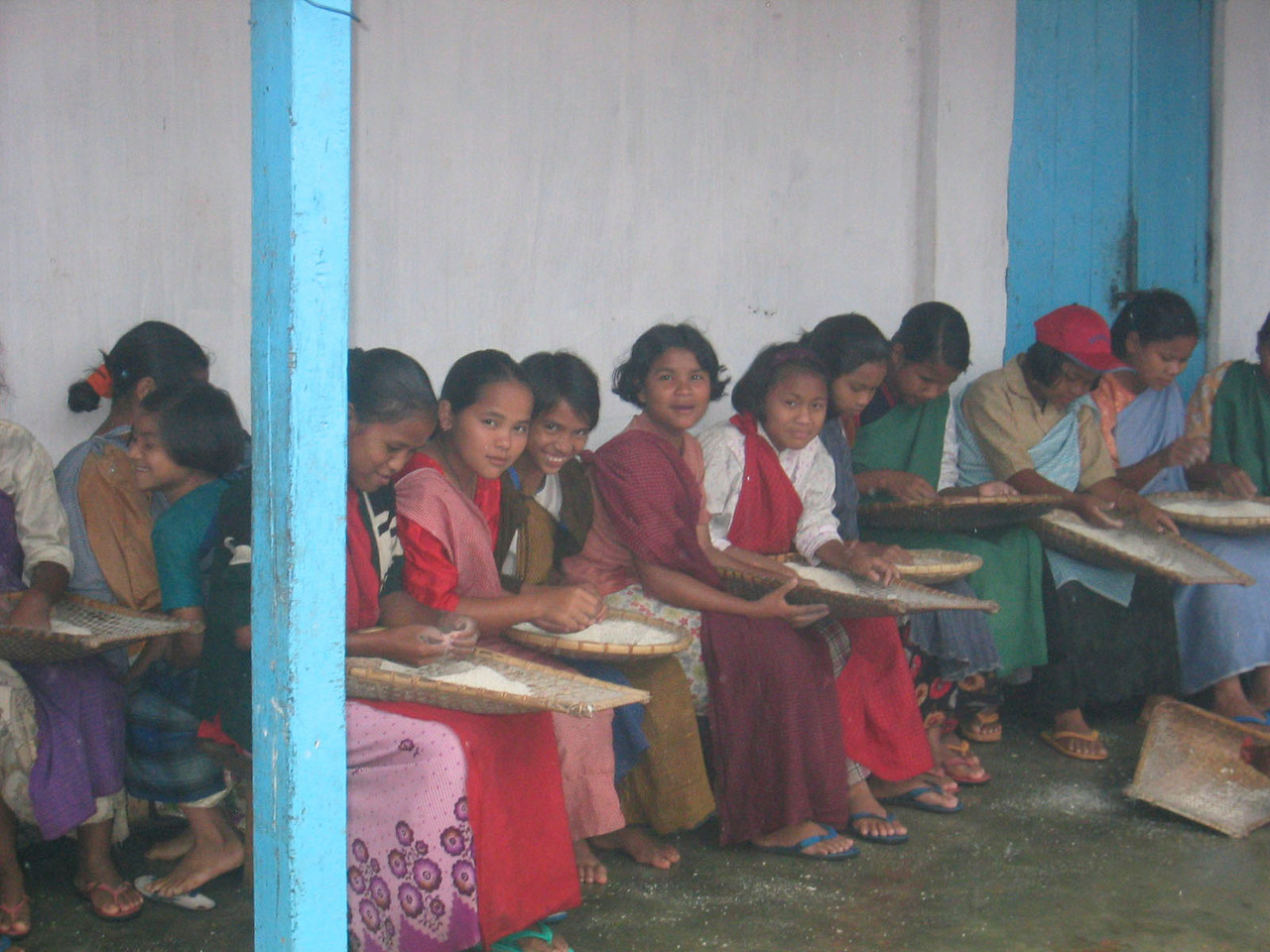 With plentiful rain, rice is a staple food in Maweit. Girls must perform the tedious task of sorting the rice to remove soil, small stones, and pests.