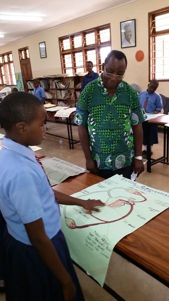 Fr. Jerome Amone Manyahi, SJ, with a student at St. Ignatius Preparatory and Primary School, Dodoma, Tanzania