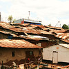 Kibera Slum with the original school structure - the blue structure top and center.