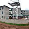 A panoramic view of the new school buildings inlcuding the water tower in front.