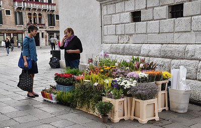 A flower vendor on a small square.