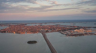 Flying into Venice as the sun sets, you can see the big causeway leading to the outskirts of the city.  But no cars are permitted in the city, because, well, you will see.