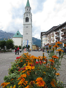 It's less than 150 km from the airport to Cortina.  The drive is supposed to take two hours, but plan on three.  But since it was mid-afternoon when we arrived, we thought we would walk a few hundred meters to the town square and scope out some of the stores.  The famous clock tower is in the background.