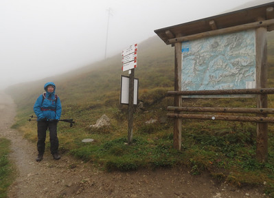 We had checked the web cams up at the Pass, and things did not look too bad.  However,as we headed up to Passo Pordoi, we noted the fog rolling in.  By the time we arrived, the fog was so thick that it was really hard to FIND the trail head.