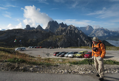 "The trailhead for Tre Cime, or the Three Towers, I guess, is about an hours drive outside of town.  To get to the trailhead, you have to pay 25 Euros on a toll road.  But hey:  parking is ""free""  Here, we have suited up and are climbing above the parking area.  We were simply ahead of the hoards."