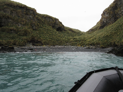 Into Cave Cove, the tiny spot where Shackleton's six man team first made landfall.  I doubt if the red plastic trash was there 100 years ago.