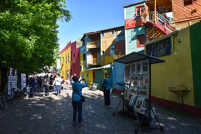 The buildings are painted quite colorfully.  There's Susie capturing some of the funkiness of the place.