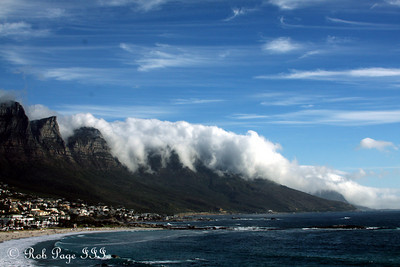 The clouds roll off of the mountains and back into the sea - Cape Town, South Africa ... March 11, 2010 ... Photo by Rob Page III