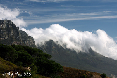 The clouds come rolling off the mountains and down into the sea - Cape Town, South Africa ... March 11, 2010 ... Photo by Rob Page III