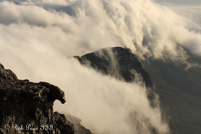 Clouds roll off the mountain and into the ocean - Cape Town, South Africa ... March 11, 2010 ... Photo by Rob Page III
