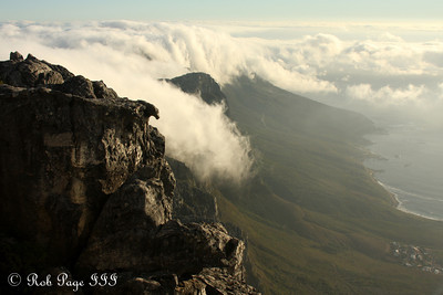 Clouds roll off the back of Table Mountain into the Atlantic - Cape Town, South Africa ... March 11, 2010 ... Photo by Rob Page III