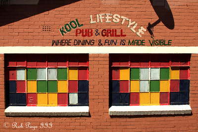 A colorful pub & grill in one of the Townships - Cape Town, South Africa ... March 11, 2010 ... Photo by Rob Page III