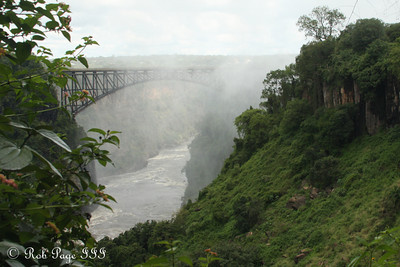 The Victoria Falls Bridge connecting Cambia to Zimbabwe - Livingstone, Zambia ... March 17, 2010 ... Photo by Rob Page III
