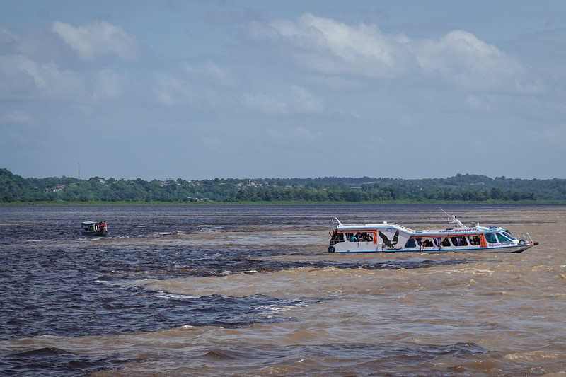 The confluence of the River Negro (Black River) and the River Amazona (Amazon River)  outside Manaus, Brazil.