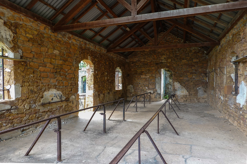 Interior of a more modern but still extremely old and deteriorated prisoner quarters on Ile Royale.