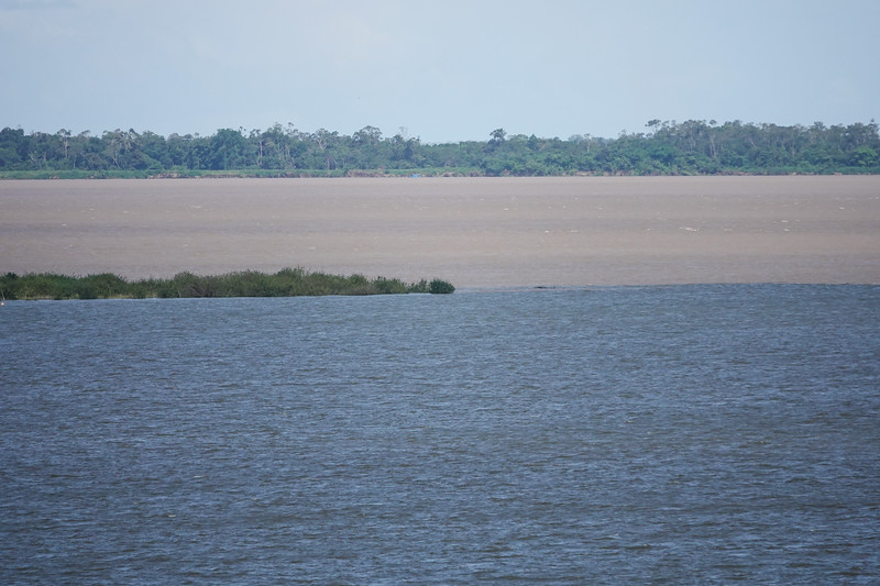 Confluence of the clear Tapajos River and the muddy Amazon in Santarem, Brazil.