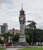 Clock Tower monument in Belen with graffetti and garbage,