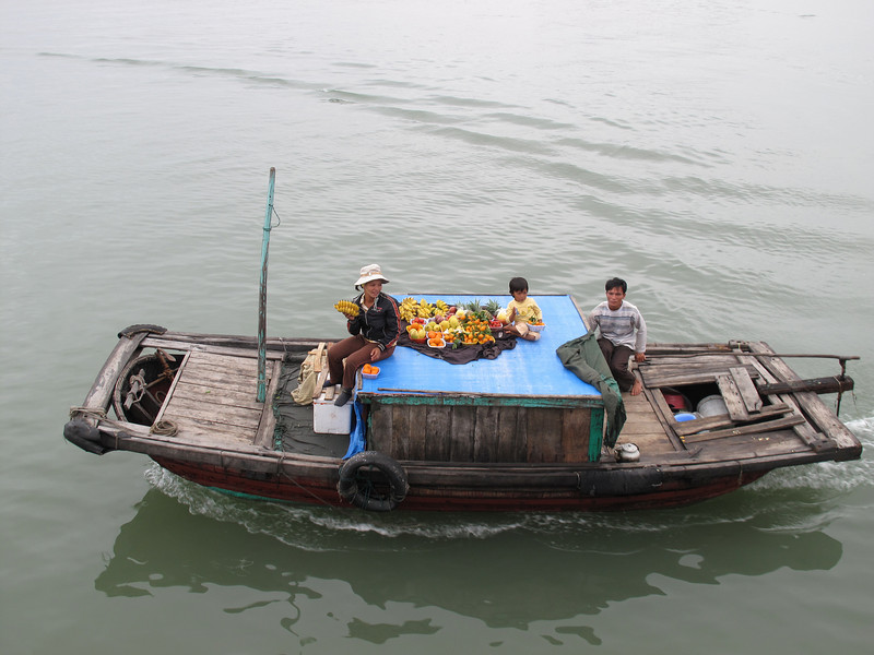 Food Sellers approaching our Excusion Boat touring Ha Long Bay - This is their live aboard home.