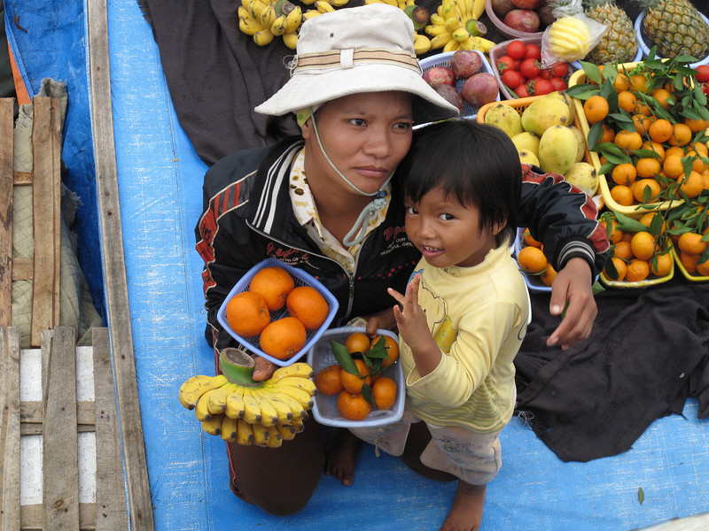Food sellers coming to our Tour Boat - Ha Long Bay