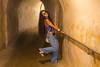 Pla posing in a tunnel in San Cristobal Fort in San Juan.