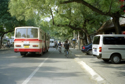 A street scene near Beijing Univeristy.  There is a special lane for the bikes. ... August 4, 2004 ... Copyright Robert Page III