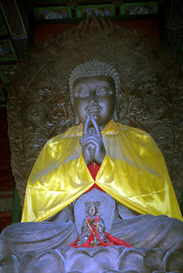 The Buddha that was inside the structure at the top of Coal Hill north of the Forbidden CIty. ... August 2, 2004 ... Copyright Robert Page III