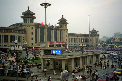 The chaos that is Beijing Train Station.  This is just one of the four stations that serves Beijing.  There is an elborate network of trains thoughout China and we were on a nice train to Shanghai. ... August 5, 2004 ... Copyright Robert Page III