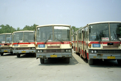 A bus terminal near the Summer Palace.  The busses were the lifeblood of the city, but they were hard to navigate at times.  Pedro and I hopped one, but went the wrong direction. ... August 5, 2004 ... Copyright Robert Page III