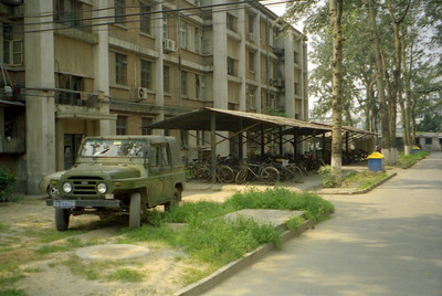 A military vehicle parked outside an apartment complex across the street from Beijing University. ... August 5, 2004 ... Copyright Robert Page III