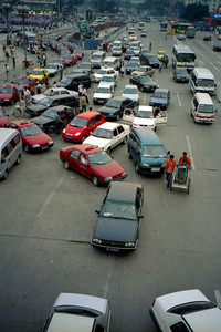 The craziness that reigns on some of Beijing's streets. ... August 5, 2004 ... Copyright Robert Page III