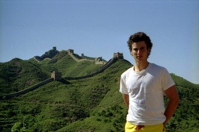 Pedro Mendoza wearing our handmade DPE shirt on the Great Wall of China at Simatai. ... August 3, 2004 ... Copyright Robert Page III