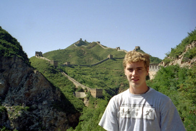 Rob Page with the Great Wall of China behind at Simatai near Beijing City. ... August 3, 2004 ... Copyright Robert Page III