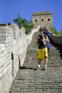 Pedro Mendoza hiking along the top of the Great Wall at Simatai. ... August 3, 2004 ... Copyright Robert Page III