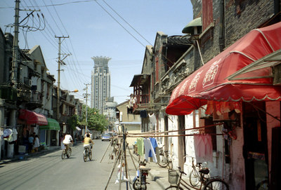 One of Shanghai's modern skyscrapers rising over a sidestreet. ... August 9, 2004 ... Copyright Robert Page III