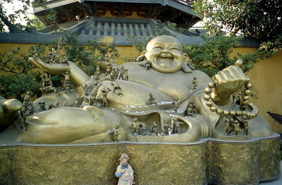 A laughing Buddha at the East side of the Longhua Pagoda. ... August 7, 2004 ... Copyright Robert Page III