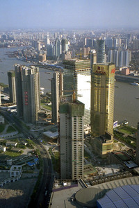 The construction of multiple skyscrapers in the Pudong District of Shanghai immediately surrounding the Pearl TV Tower and the Jin Mao Tower. ... August 9, 2004 ... Copyright Robert Page III