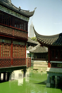 The Mid-Lake Pavillion Teahouse in the Shanghai Old City area with the Jin Mao building in the background. ... August 9, 2004 ... Copyright Robert Page III