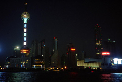 The Pearl TV Tower rises above the rest of the Pudong District in Shanghai.  To the right, set back from the river is the Jin Mao building, one of the tallest in the world. ... August 6, 2004 ... Copyright Robert Page III