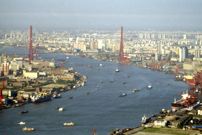 This is the Yangpu Bridge over the Huangpu River in Shanghai.  It was constructed in 1993.  Notice all the boat traffic and hardly any of it is recreational. ... August 9, 2004 ... Copyright Robert Page III