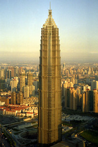 The Jin Mao Tower (421m/1,380f, 88 stories, built in 1998) from the Pearl TV Tower.  In a couple of years there will be an even taller tower to the right of the Jin Mao building. ... August 9, 2004 ... Copyright Robert Page III