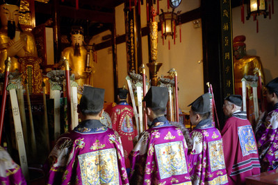 A ceremony taking place within the Old City God's Temple located within Shanghai Old City.  It was built during the reign on Yongle during 1403-1424 and was very popular during the Qing Dynasty. ... August 9, 2004 ... Copyright Robert Page III