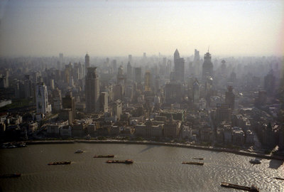 Looking out from the Pearl TV Tower you can see the river traffic and then the Bund District  before all of the other buildings begin to rise up and above the city. ... August 9, 2004 ... Copyright Robert Page III