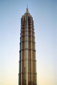 The Jin Mao Tower (421m/1,380f, 88 stories, built in 1998) dwarfing the other buildings around it in the late evening sun. ... August 9, 2004 ... Copyright Robert Page III