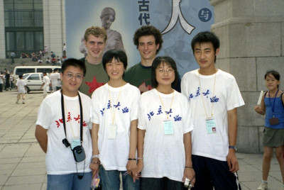 A group of students who came up to me and Pedro to ask for our photos because we were Westerners.  This went on for fifteen or so minutes.  As I walked across the Tiananmen Square one girl wrapped herself around me as her father took a photo. ... August 2, 2004 ... Copyright Robert Page III