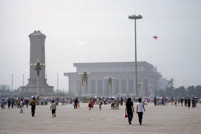 Tiananmen Square with the Monument to the People's Heroes and the Mao Zedung Memorial Hall in the background.  Thousands of people visit the square each day and it is 440,000 square metres. ... August 2, 2004 ... Copyright Robert Page III