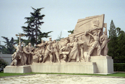 A Monument to the workers of China next to Mao's Mauseleum. ... August 2, 2004 ...  Copyright Robert Page III